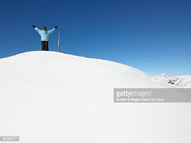 Skier admiring mountain view