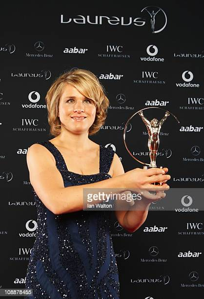 """Skier and Biathlete Verena Bentele of Germany poses with her award for """"Laureus World Sportsperson of the Year with a Disability"""" in the winners..."""