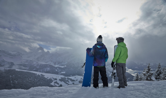 Skier and snowboarder look out over The Alps. - gettyimageskorea
