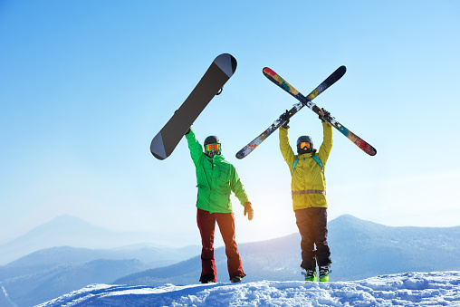 Skier and snowboarder mountain top 625705606