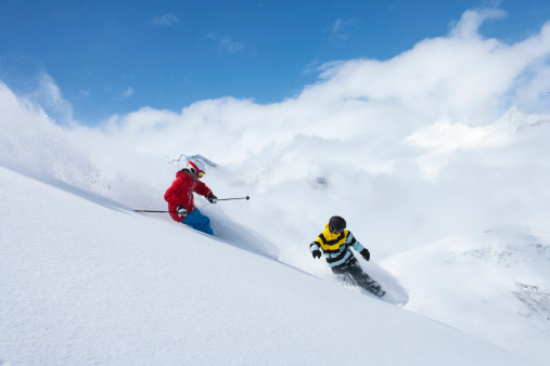 Skier and snowboarder on snowy slope - gettyimageskorea