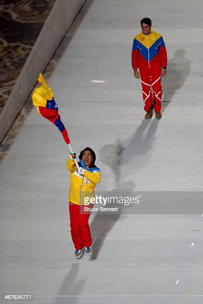 Skier Antonio Pardo of the Venezuela Olympic team carries his country's flag during the Opening Ceremony of the Sochi 2014 Winter Olympics at Fisht...