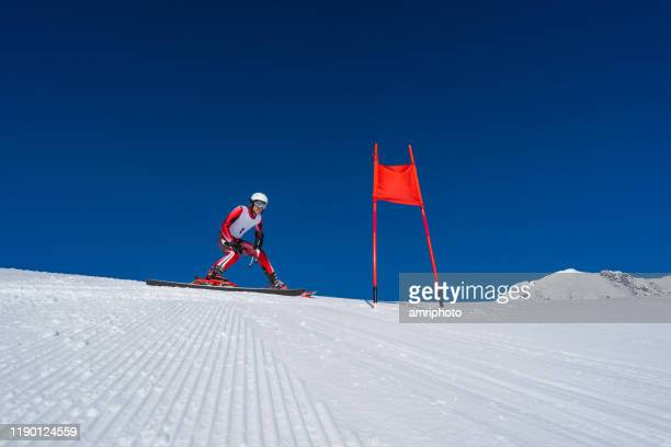 skier athlete learning race course, perfect weather conditions - ski racing stock pictures, royalty-free photos & images