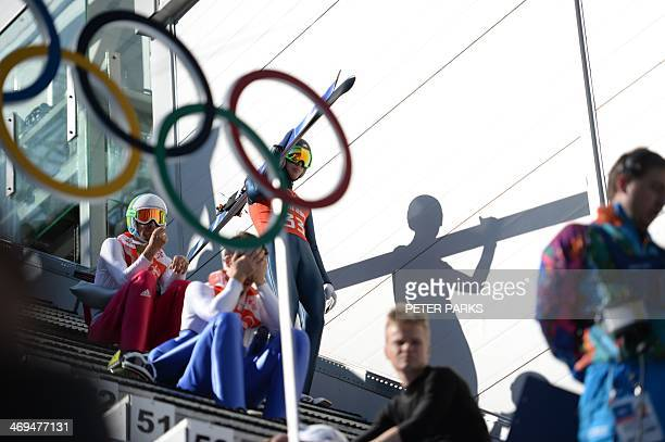 Skier Bill Demong arrives for the Nordic Combined Individual NH / 10 km Ski Jumping official training Jump 1 at the RusSki Gorki Jumping Center...