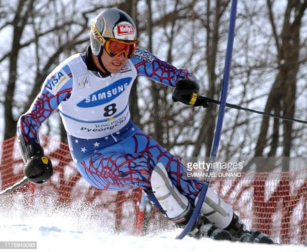 US skier Bode Miller powers his way to sixth position 02 March 2003 in the World Cup Men's Slalom in Yongpyong some 250 kilometres east of Seoul...