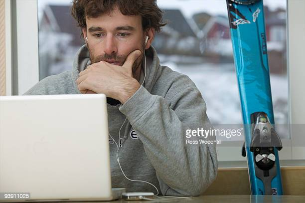 Skier checking his email.
