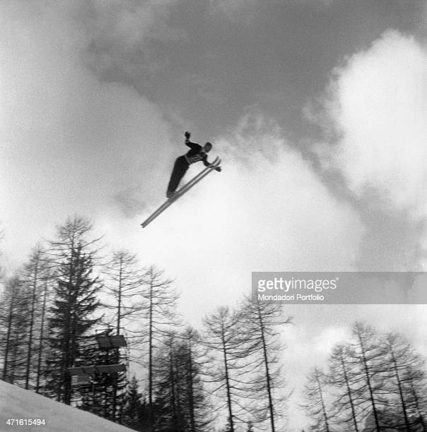 A skier competing in the VII Olympic Winter Games performing a jump Cortina d'Ampezzo 1956