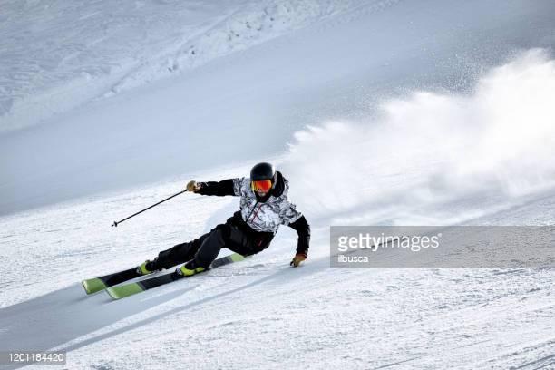 skier curving in alps ski resort, alpe di mera, piedmont, italy - ilbusca foto e immagini stock