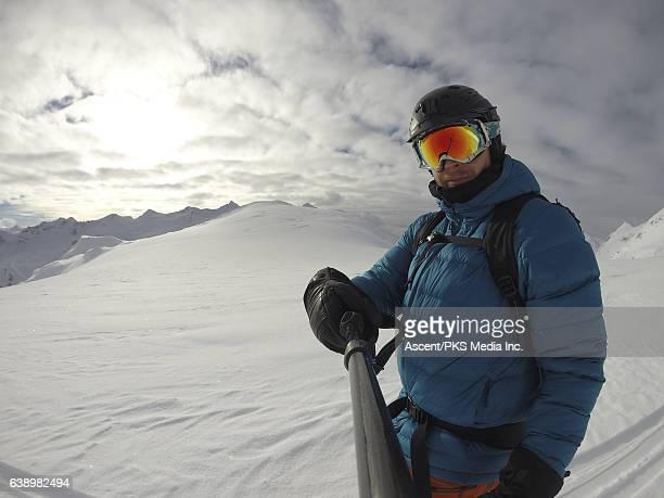 POV of skier descending deep powder snow, high mountains