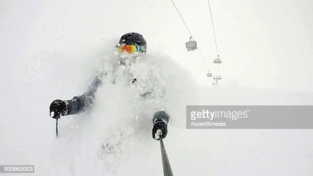 POV of skier descending though deep powder snow