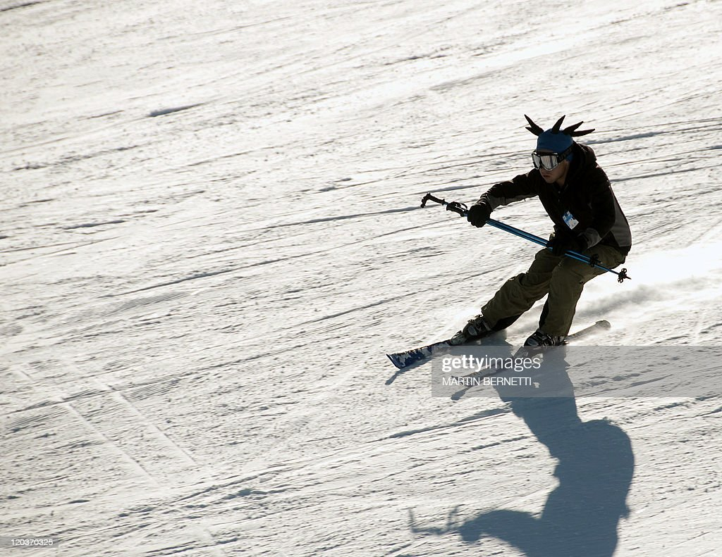 A skier descends a mountain at El Colorado skiing centre, in the Andes Mountains, some 30 km from Santiago on July 3, 2011. Thousands of tourists are scheduled to arrive during winter at this centre, located at 2,300 metres above sea level in central Chile. AFP PHOTO/Martin Bernetti