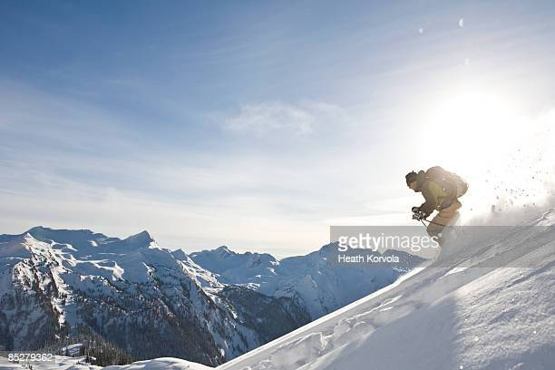 a skier descends. - mid adult men stock pictures, royalty-free photos & images