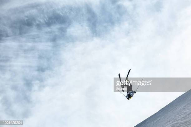 skier doing a backflip jump in alps ski resort, alpe di mera, piedmont, italy - piedmont italy stock pictures, royalty-free photos & images