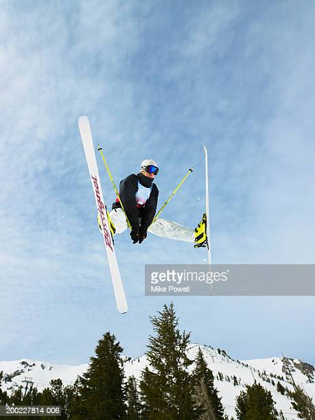Skier doing freestyle jump in air