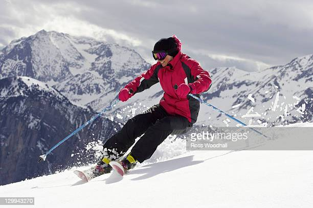 Skier doing tricks on slope