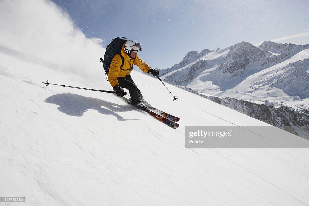 Skier downhill : Stock Photo