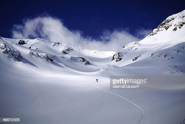 Skier enjoys the slopes of the Pirin Mountains on March 3, 2015. Bulgaria receives more than 13% of its GDP from low-cost tourism in its three major...