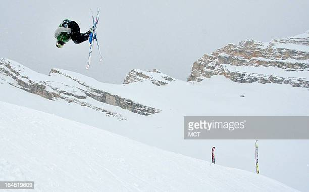 A skier executes a flip from a jump in a terrain park on the Zugspitze glacier ski area near GarmischPartenkirchen Germany April 8 2012 This photo...