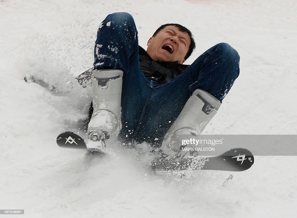A skier falls during Lunar New year holidays at the Jundushan Ski resort after the first snowfall of the winter fell in Beijing on February 7, 2014. China has an estimated skiing population of over 10 million and the Chinese Olympic Committee recently submitted their bid for Beijing and Zhangjiakou in Hebei Province to jointly host the 2022 Winter Olympics. AFP PHOTO/Mark RALSTON