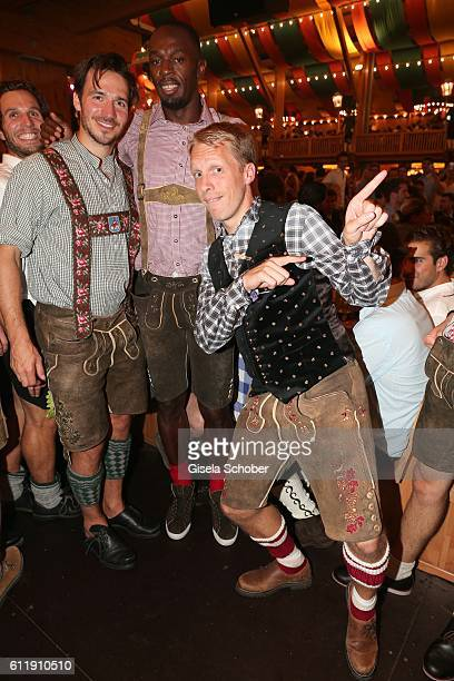 Skier Felix Neureuther and Usain Bolt sprinter ninefold olympic champion and elevenfold world champion and Oliver Pocher during the Oktoberfest at...