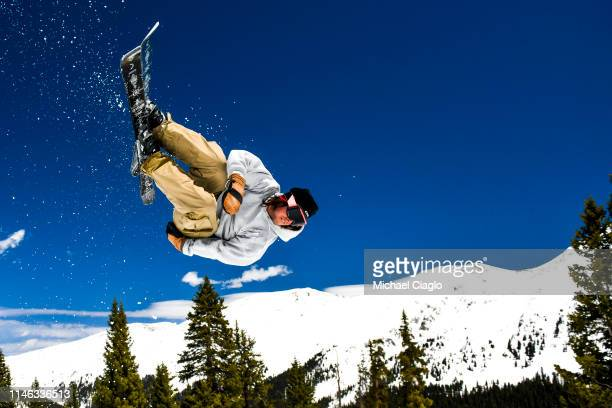 A skier flies over a jump at the Treeline Terrain Park at Arapahoe Basin Ski Area on May 25 2019 in Dillon Colorado Even as temperatures are expected...