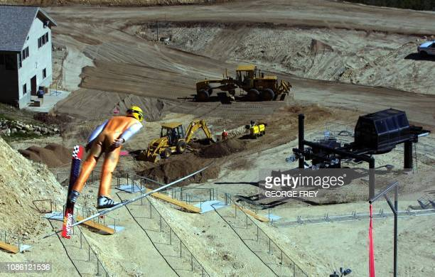 A skier flies through the air off the K90 jump during a summer joint USA / Canada training session at the Utah Olympic Park 15 June 2001 in Park City...
