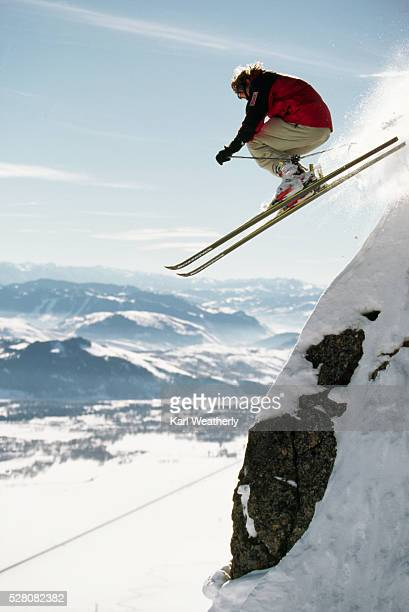 skier flying off a cliff - jackson hole stock pictures, royalty-free photos & images