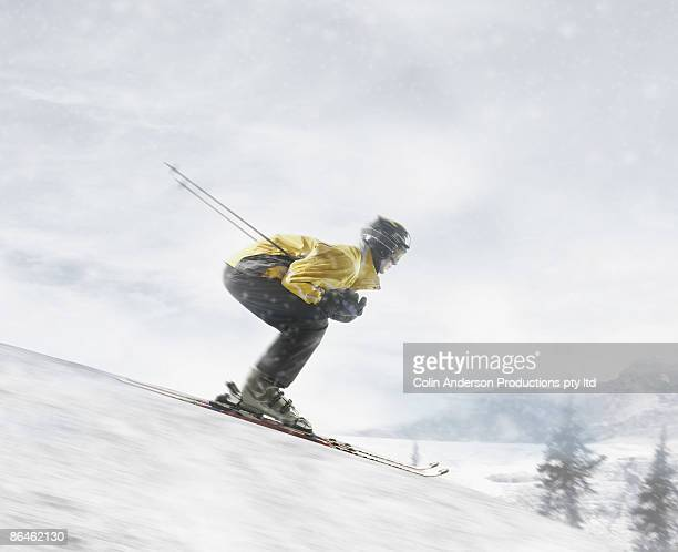 Skier gaining momentum on slope