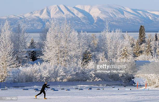 A skier glides across the groomed snow in stadium at Kincaid Park in Anchorage Alaska on Sunday January 4 on the second day in a row that the US...