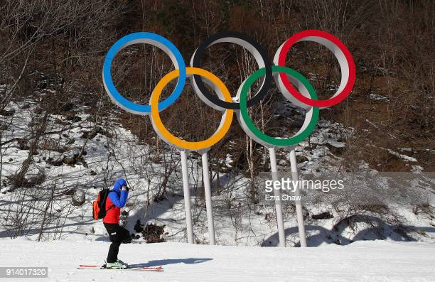 A skier goes past the Olympic rings at the Jeongseon Alpine Centre prior to the PyeongChang 2018 Winter Olympic Games on February 4 2018 in...