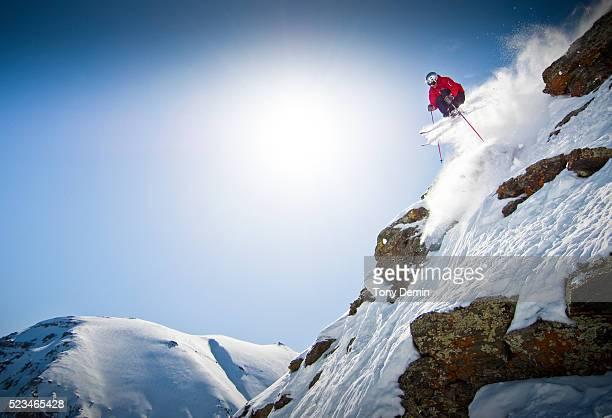 Skier going over cliff
