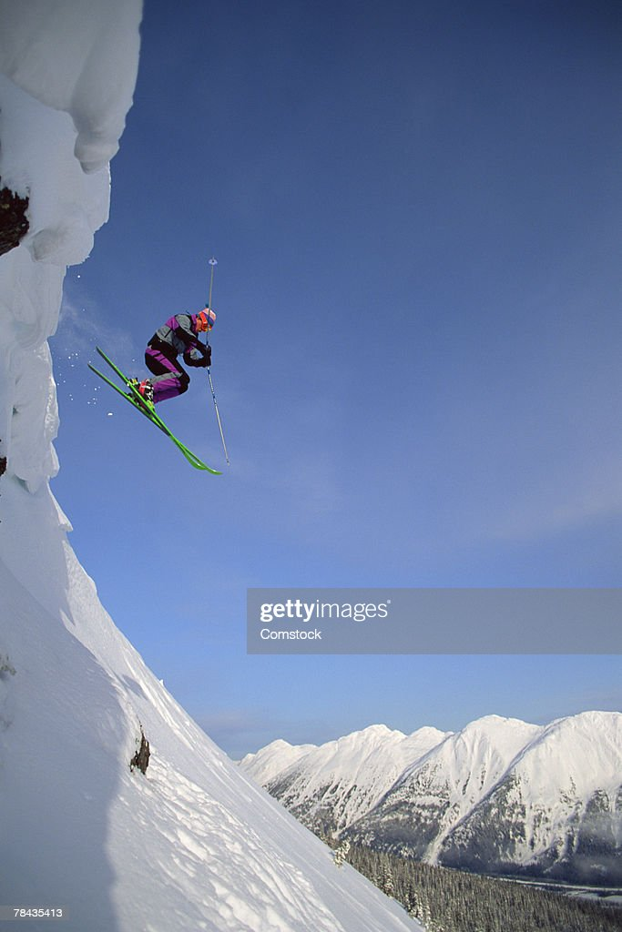 Skier going over jump , British Columbia , Canada : Stockfoto