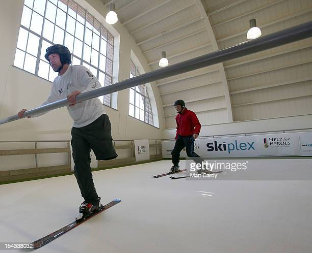 Skier Graham Bell shows amputee Andy Barlow how to ski on the new Skiplex slope that has been installed at the new Help for Heroes' Tedworth House...