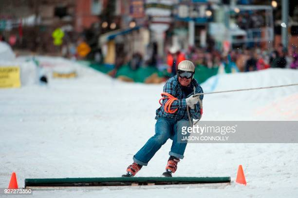 Skier Greg Dahl crosses the finish line after a clean run down Harrison Avenue during the 70th annual Leadville Ski Joring weekend competition on...