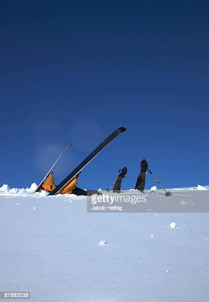 Skier head down in snow