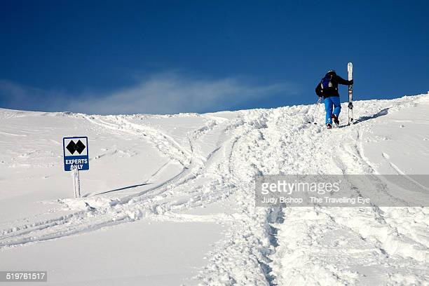 """Skier hikes up to """"Experts Only"""" ski run"""