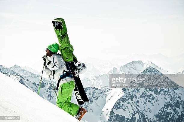 skier hiking up a steep slope