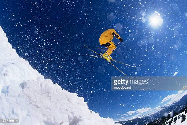 skier hitting the slopes - ski jumping stock pictures, royalty-free photos & images