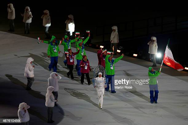 Skier Hossein Saveh Shemshaki of the Iran Olympic team carries his country's flag during the Opening Ceremony of the Sochi 2014 Winter Olympics at...