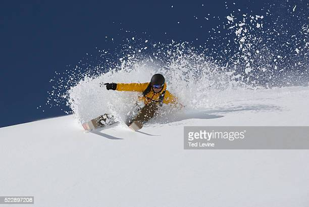 skier in deep powder snow - アロサ ストックフォトと画像