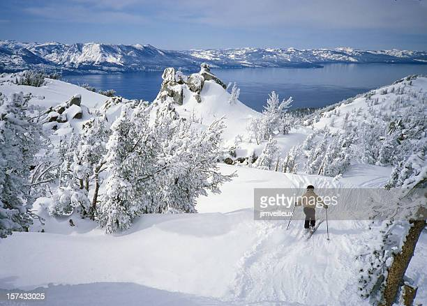 skier in fresh snow above alpine lake tahoe - lake tahoe stock pictures, royalty-free photos & images