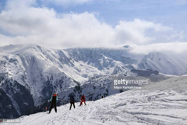 Skier in front of a cloudy landscape