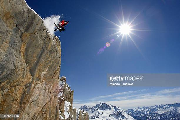 skier in midair on snowy mountain - rock formation stock pictures, royalty-free photos & images