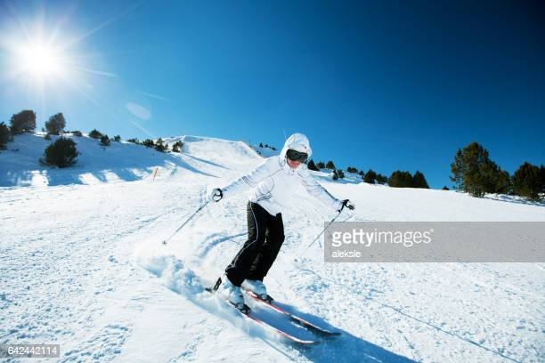 skier in mountains - downhill skiing stock pictures, royalty-free photos & images