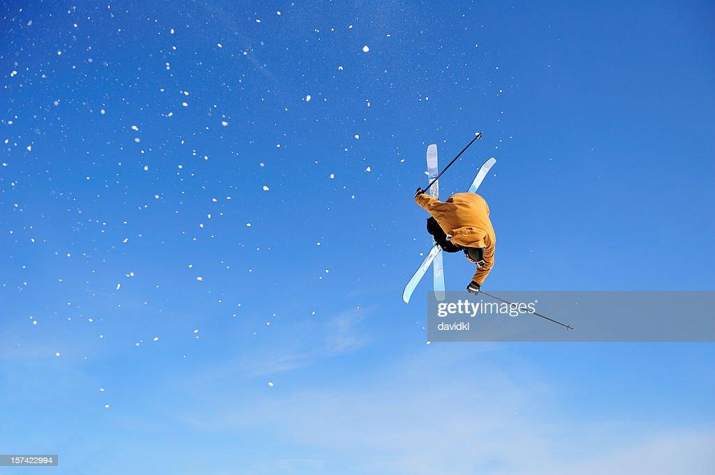 Skier Iron Cross stunt against blue sky : Stock Photo