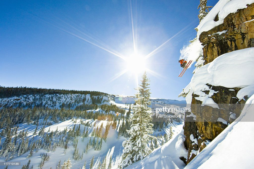 Skier jumping cliff on sunny winter day. : Stock Photo
