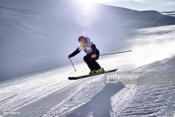 skier jumping in alps ski resort, alpe di mera, piedmont, italy - ilbusca foto e immagini stock
