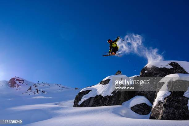 skier jumping into fresh powder - downhill skiing stock pictures, royalty-free photos & images