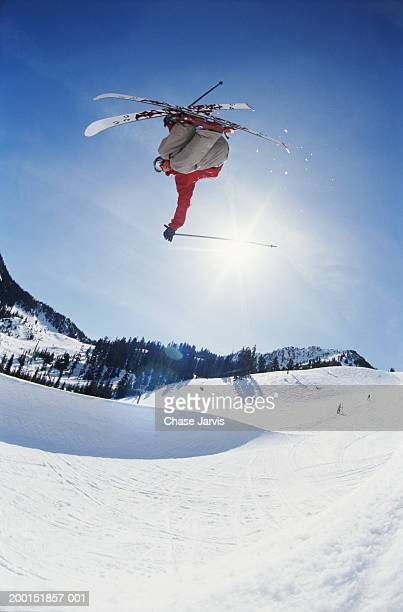 skier jumping mogul - freestyle skiing stock pictures, royalty-free photos & images