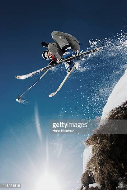 skier jumping off cliff with powder snow - innsbruck stock pictures, royalty-free photos & images
